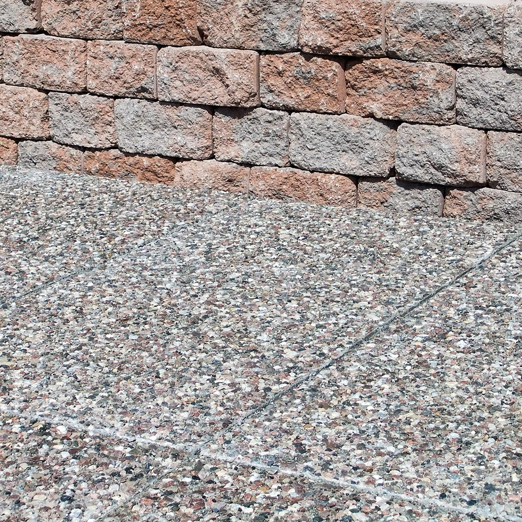 Exposed Aggregate paver, ottawa with Tumble Stack wall, huron range